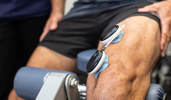 electrical muscle stimulation (EMS) therapy on leg with Compex